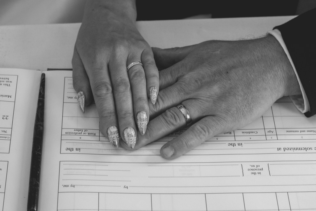 2 hands on wedding register